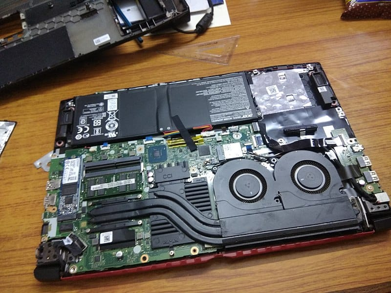 laptop fan visible on open backside of laptop